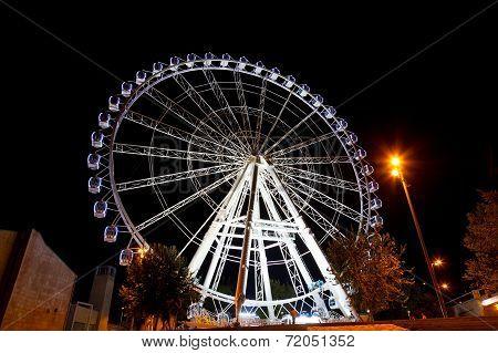 Working feris wheel at night in Zaragoza Spain