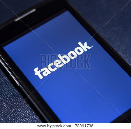 Belgrade - February 02, 2014: Logo Of Popular Social Media Website Facebook On Smart Phone Screen