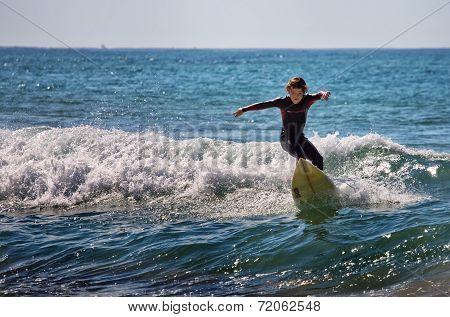 Boy surfing in Australia