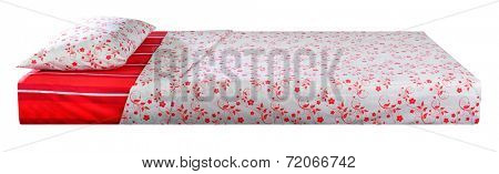 Bed covered with bed spreads and soft pillow.