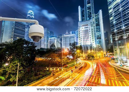 urban city street CCTV with traffic light trail background