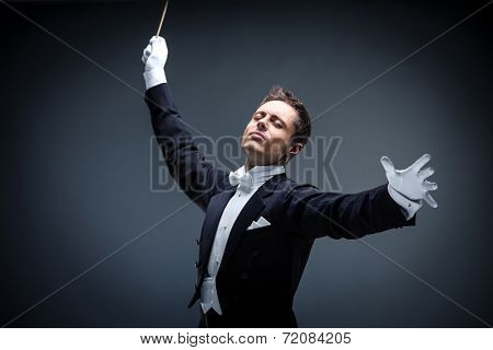 Emotional conductor in a tuxedo on a dark background poster