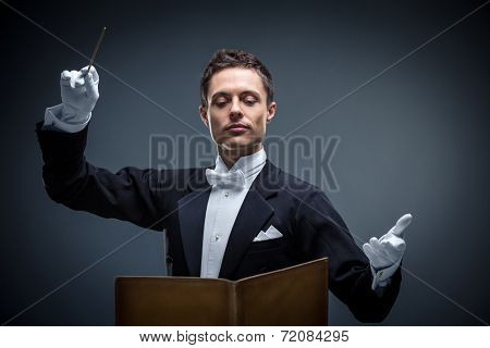 Young conductor in a tuxedo poster