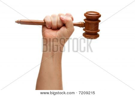 Man Holding Wooden Gavel In Fist On White