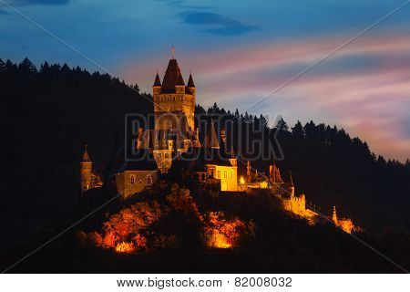 Cochem Imperial Castle on mountain at night