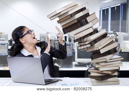 Indian Employee With Book In Office