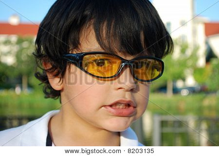 Adorable Hispanic boy wearing sunglasses