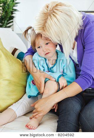 Sick Sad Child Lying On Couch