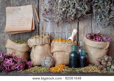 Healing Herbs In Hessian Bags Near Wooden Wall, Herbal Medicine.