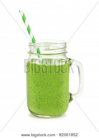 Green smoothie in a jar mug isolated