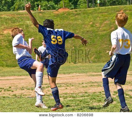 Boy's Soccer Kicking The Ball