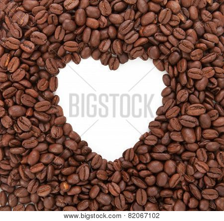 Background From Coffee Beans Laid Out In The Form Of Heart. Concept Of Love For Coffee. Isolated