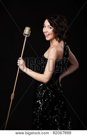 Cheerful Beautiful Girl Singer Holding Golden Vintage Microphone