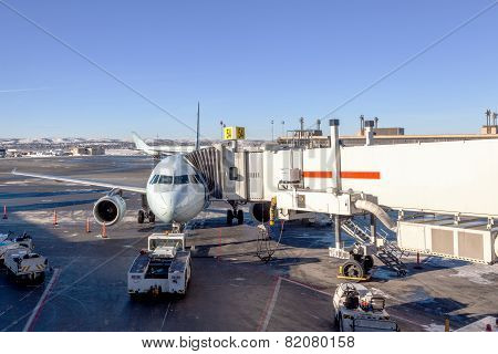 Airplane Being Serviced At Airport Gate
