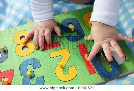 Child Playing With A Number Puzzle