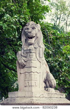 Stone lion with a board in paws near the Vajdahunyad castle