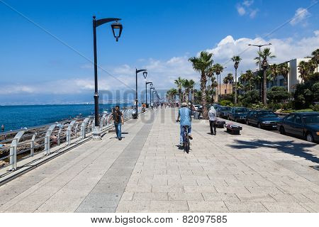 An unidentified locals walk along the beach around quay in Beirut