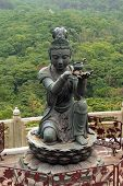 """six bronze statues known as """"The Offering of the Six Devas"""", symbolise charity, morality, patience, zeal, meditation, and wisdom, all of which are necessary to enter into nirvana, Po Lin Monastery, Lantau Island, Hong Kong poster"""