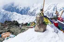 Leinin head statue at the top of Lenin Peak Pamir Mountains Kyrgyzstan