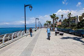 An unidentified locals walk along the beach around quay in Beirut