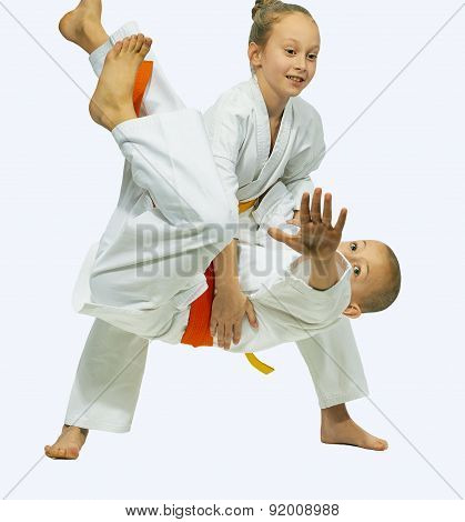 Children in karategi are trained judo throws