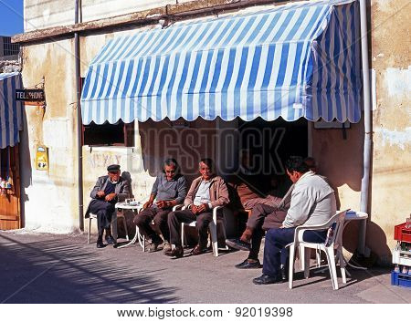 Locals outside bar, Cyprus.