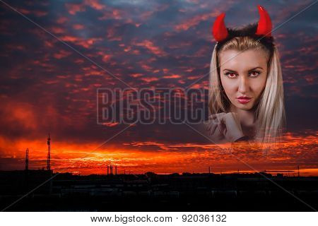 Beautiful Woman With Red Demon Horns At The Background Of The Sunset