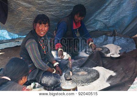 Tibetan women cooking in tent