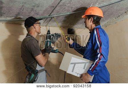 Foreman Gives Instructions To Workers