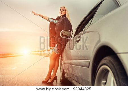 Lady In High Heel Shoes With Broked Car On The Highway