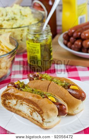 Grilled Hot Dogs on a Picnic Table