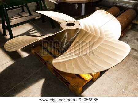 Heavy industrial shipbuilding element in workshop. Industry, naval production.