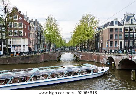 Amsterdam, Netherlands - May 7, 2015: Passenger Boats On Canal Tour In The City Of Amsterdam