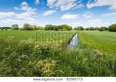 Rural Landscape Intersected Bij A Reflecting Ditch