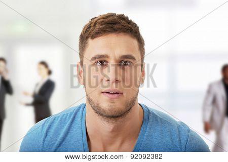 Handsome shoked man looking at camera.