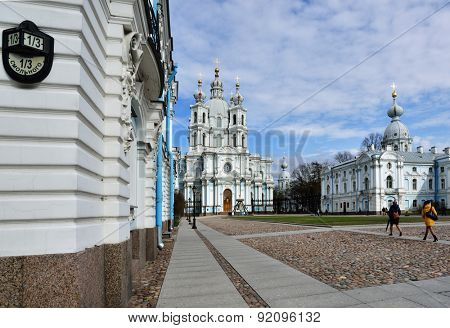 ST. PETERSBURG, RUSSIA - APRIL 27, 2015: People on the Rastrelli square in front of the Smolny Convent. The Smolny Cathedral built by the Italian architect Francesco Bartolomeo Rastrelli in 1748-1763