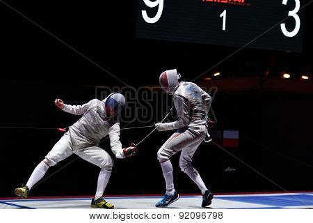 St. Petersburg, Russia - May 2, 2015: Dmitry Rigin of Russia vs Vincent Simon of France in semifinal of International fencing tournament St. Petersburg Foil. The tournament is the stage of World Cup