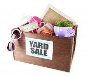 Box of unwanted stuff ready for yard sale isolated on white poster