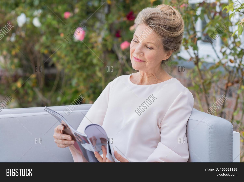 senior woman reading magazine image & photo | bigstock