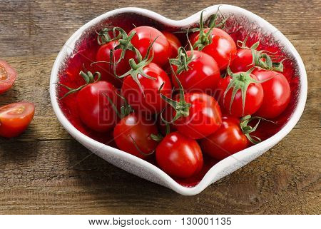 Fresh Tomatoes In Heart Shaped Plate.
