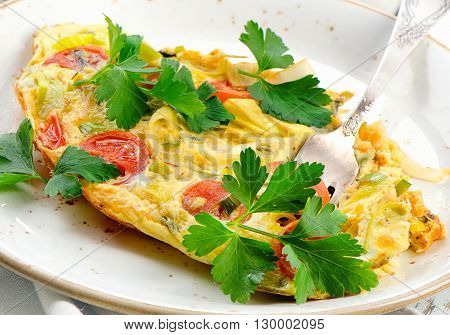 Omelet With Vegetables In White Plate.