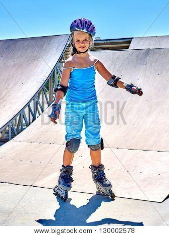 Girl riding on roller skates in skatepark. Roller skates is extreme sport.