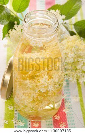 home made elderflower vinegar in a glass bottle