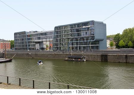 """Cologne, Germany - May 17: This is modern office """"Microsoft"""" in area Reynauhafen - promenade along the left bank of the Rhine in the city center of Cologne May 17, 2013 in Cologne, Germany."""