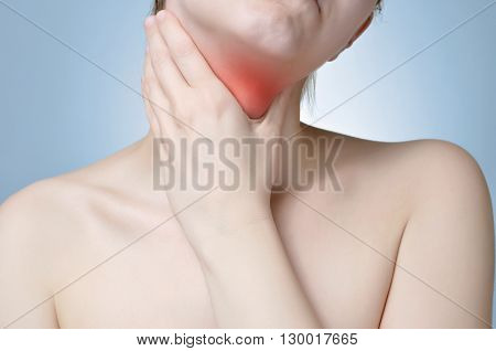 A young woman holding her painful neck