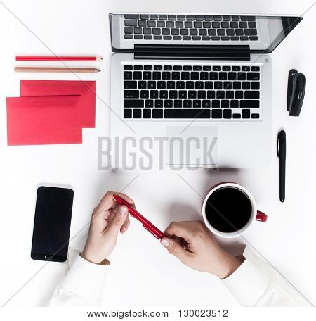Concept of comfortable male workplace. Gadgets on the white desk