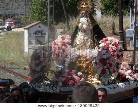 Alora Spain 24 April 2016: Religious procession crossing railway line near Alora Andalucia. Alora Spain 24 April 2016