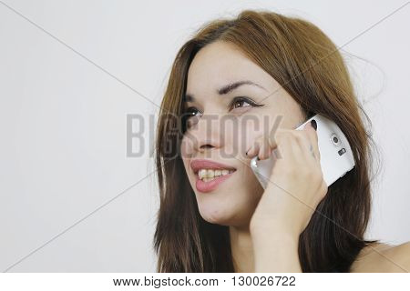 Woman usign new mobile phone with one hand at home sitting in sofa