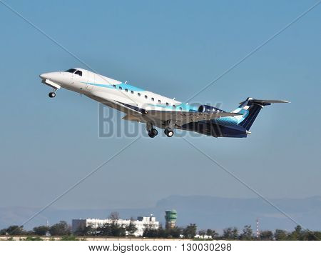 Simferopol Ukraine - September 12 2010: Embraer EMB-135BJ business jet is taking off in the evening