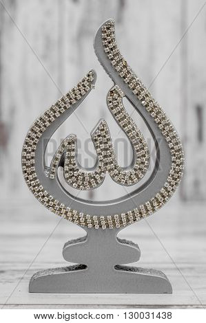 Silver And Golden Religious Statuette With The Name Of Allah